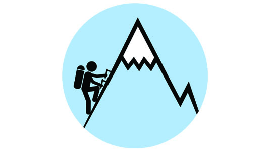 person climbing mountain